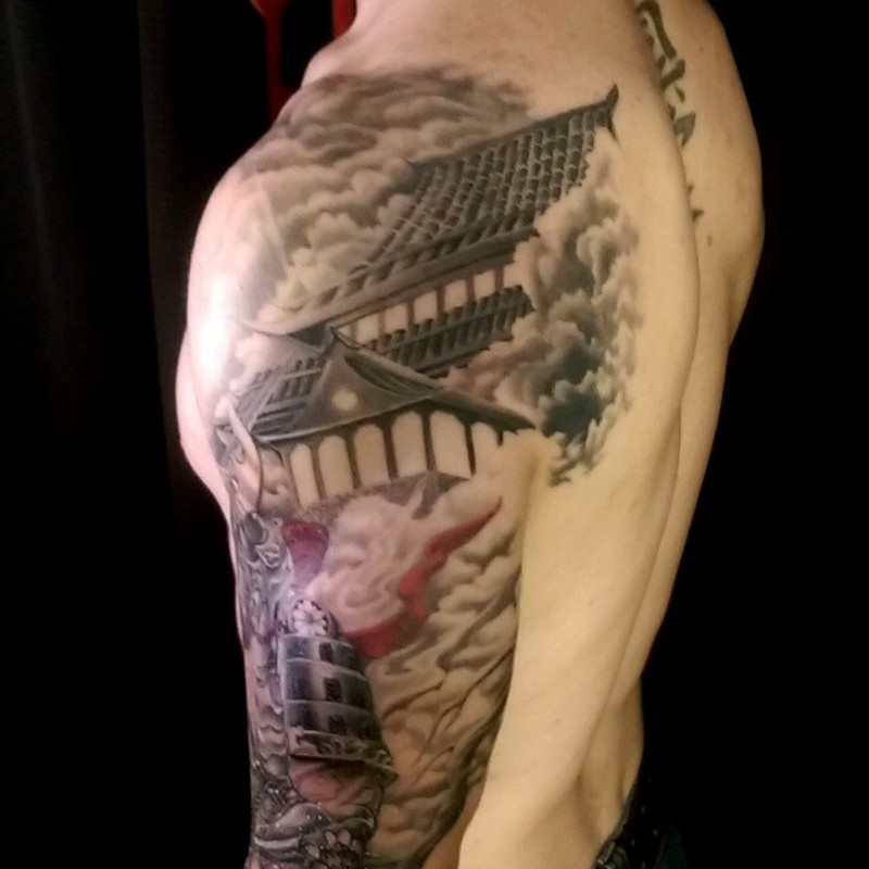 Natural looking colored shoulder tattoo of samurai warrior and old house