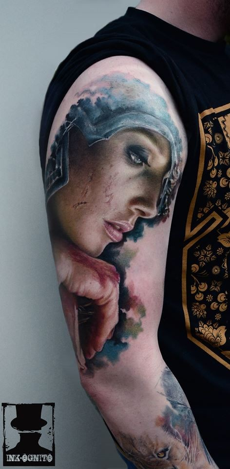 Natural looking colored shoulder tattoo of bloody woman portrait