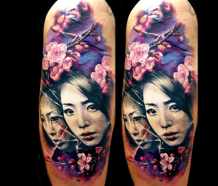 Natural looking colored shoulder tattoo of japanese women with blooming flowers
