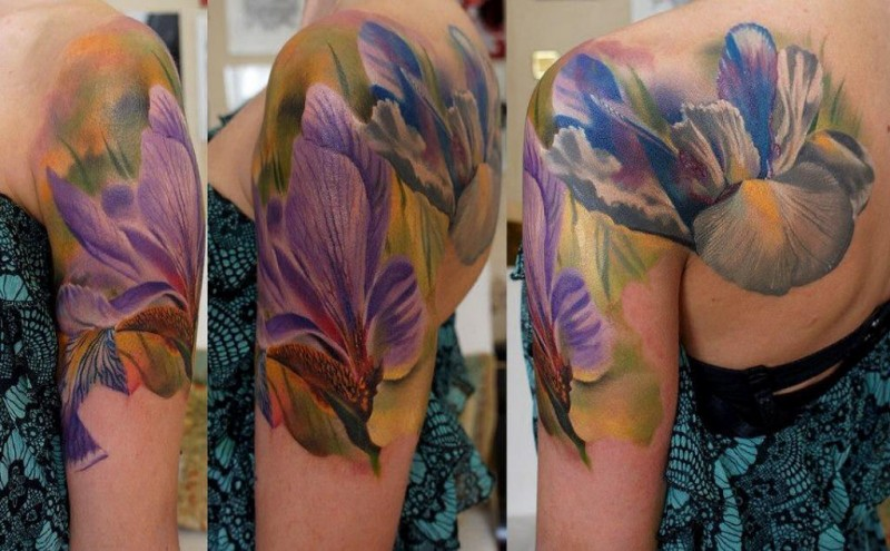 Natural looking colored shoulder tattoo of beautiful flowers