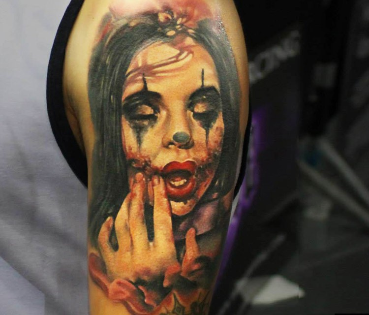 bb386f938 Natural looking colored shoulder tattoo of creepy woman clown ...
