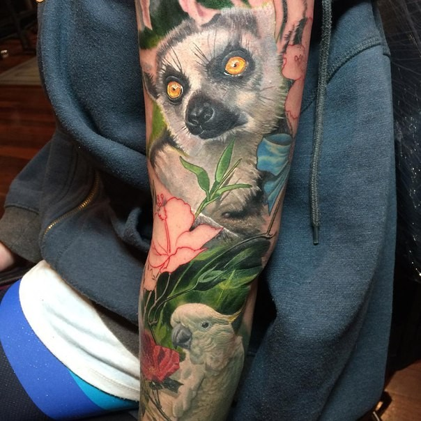 Natural looking colored sleeve tattoo of natural looking animals