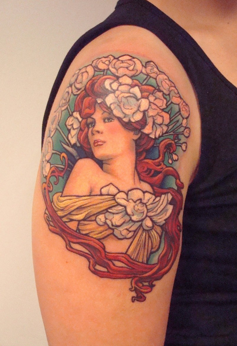 Natural looking colored small shoulder tattoo of woman portrait with flowers