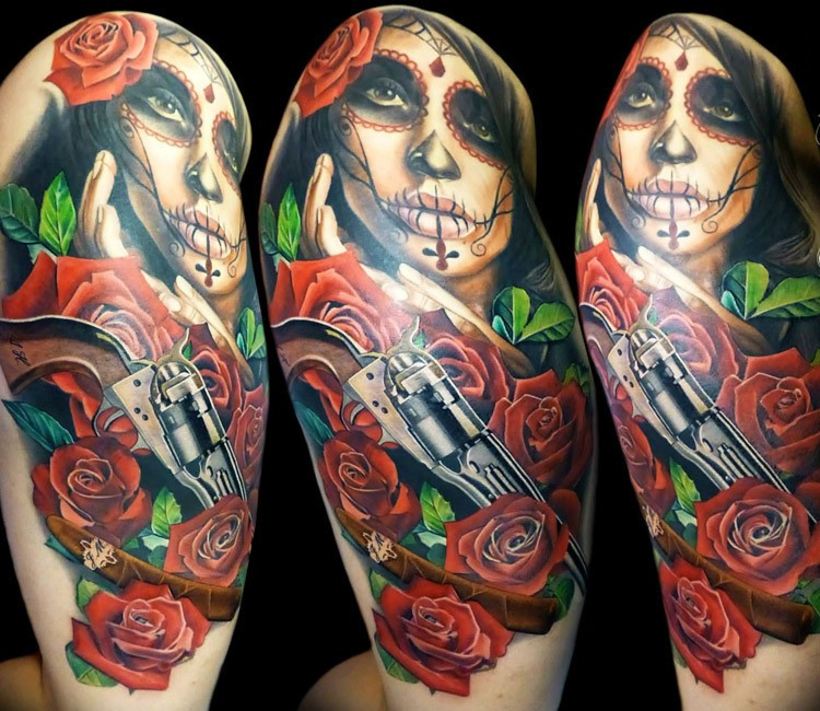 Natural looking colored tattoo of woman with old pistol and roses