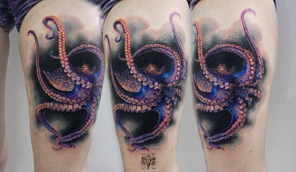 Natural looking colored thigh tattoo of octopus
