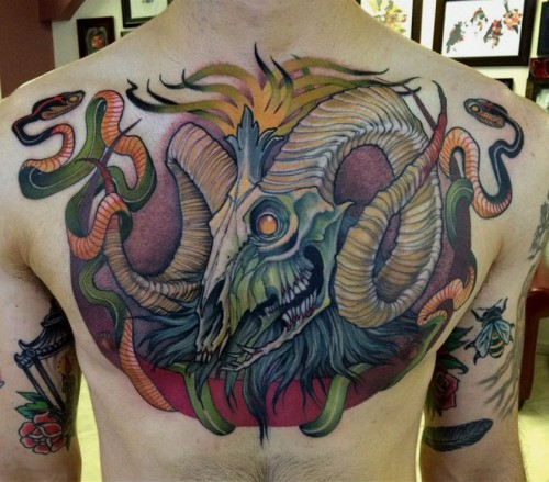 Natural looking colored very detailed and colored chest tattoo of animal skull and snakes