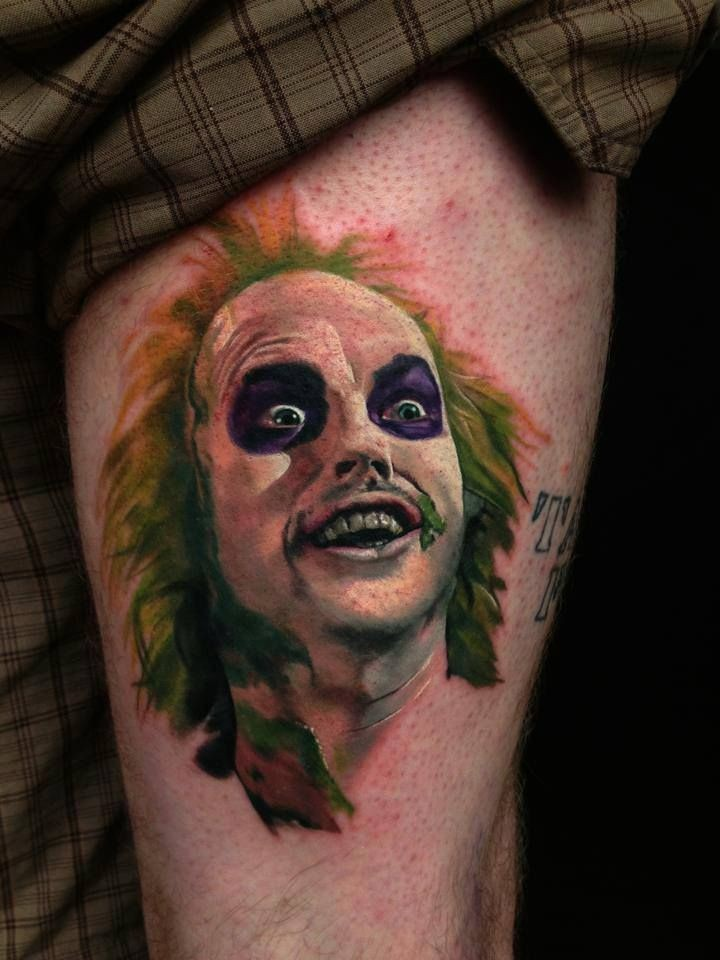 Natural looking detailed and colored thigh tattoo on crazy clown