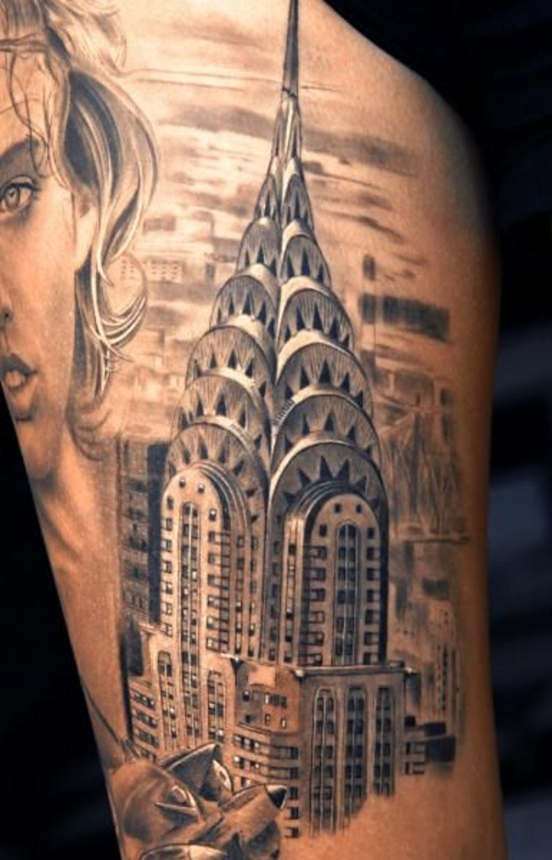 Natural looking detailed black and white shoulder tattoo of Empire State Building