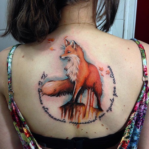 Natural looking detailed colorful big fox tattoo on back combined with lettering