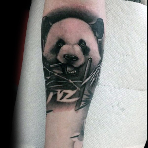 Natural looking forearm tattoo of sweet looking eating panda