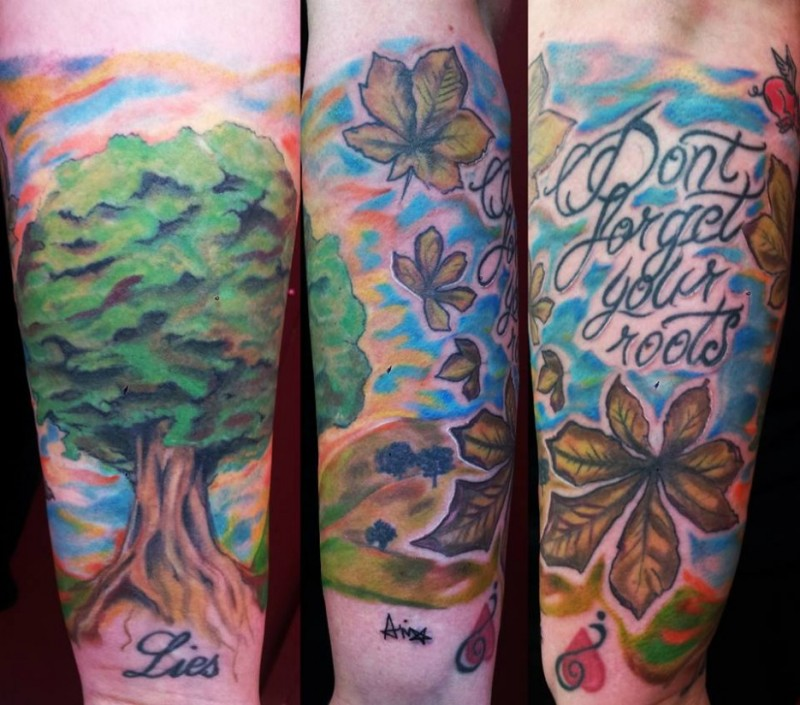 Natural looking homemade colored tree tattoo on forearm with lettering