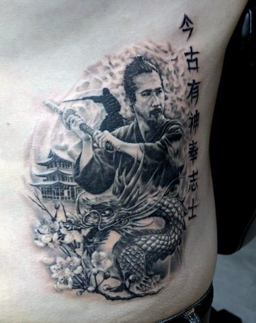 Natural looking little black ink samurai warrior tattoo on side with dragon and lettering