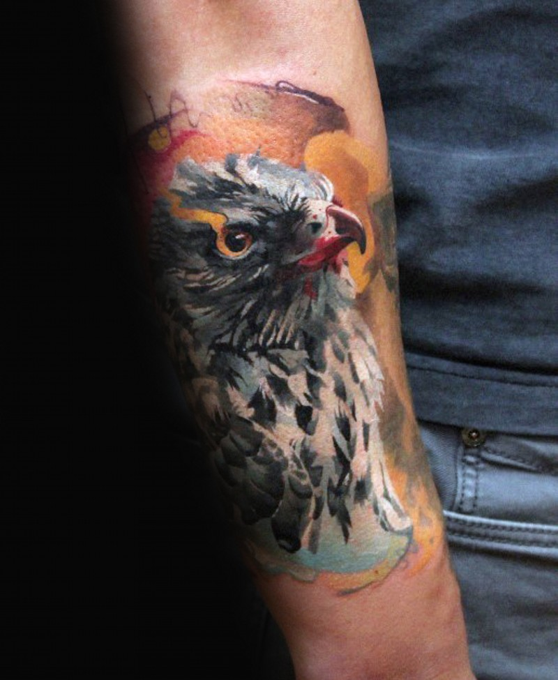 Natural looking multicolored forearm tattoo of beautiful eagle