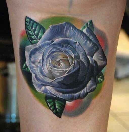 Natural looking real photo like blue colored rose tattoo on arm