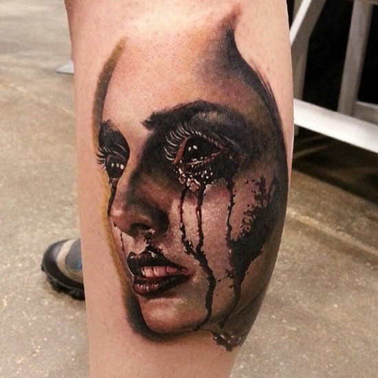 Natural looking real photo like colored demonic woman tattoo on leg muscle