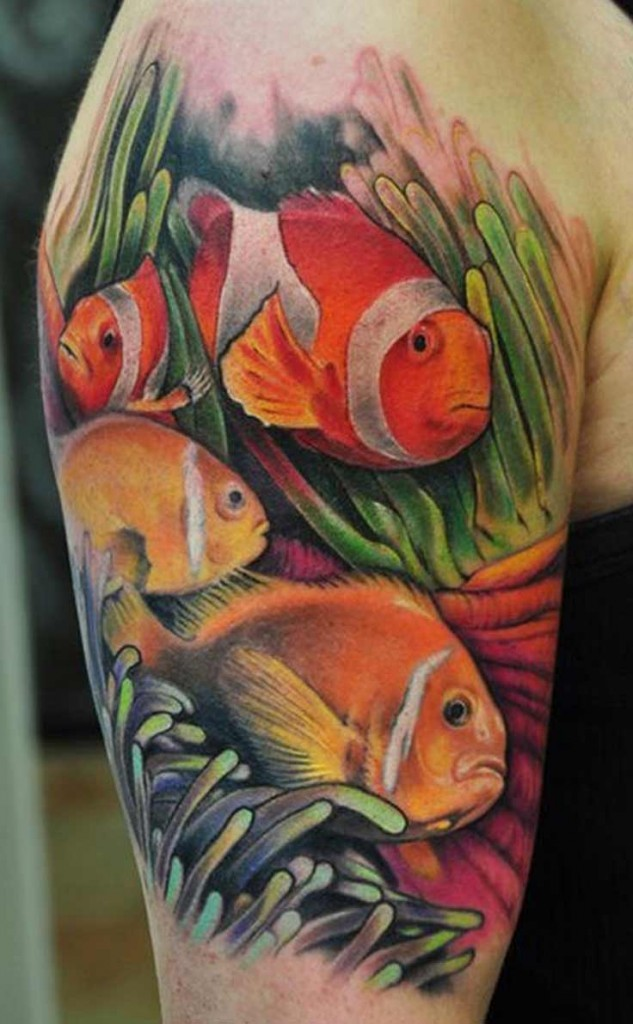 Natural looking shoulder tattoo of beautiful fishes