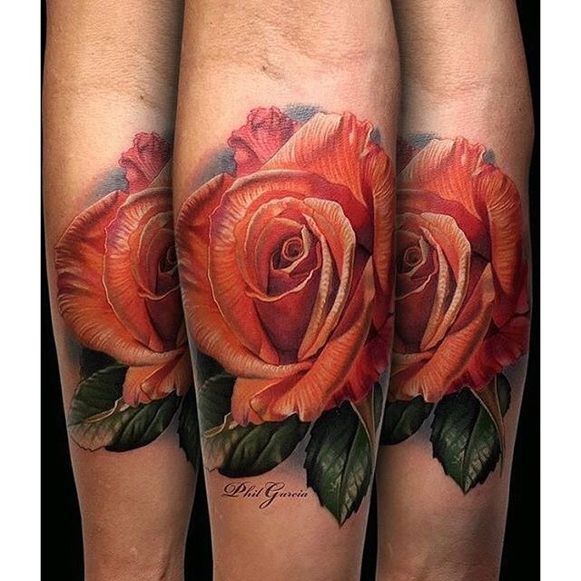 Natural looking very beautiful forearm tattoo of red rose with leaves