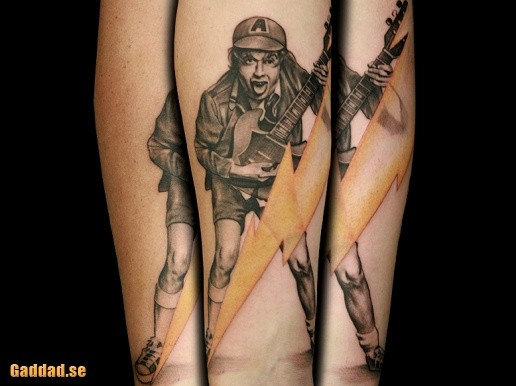 Natural looking very detailed AC/DC guitarist tattoo on forearm with lightning