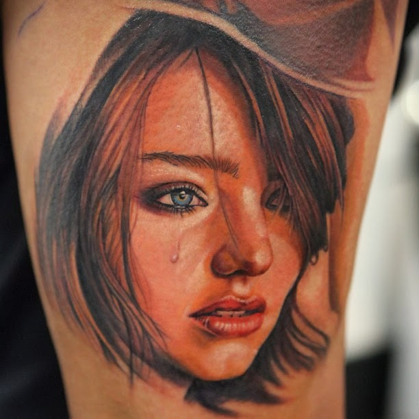 Naturally colored beautiful young crying girl&quots portrait in hat tattoo in realism style