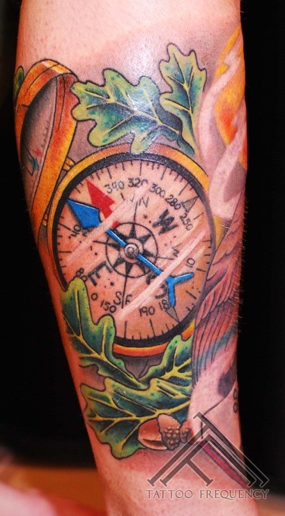 Nautical style great detailed and colored big compass tattoo on leg
