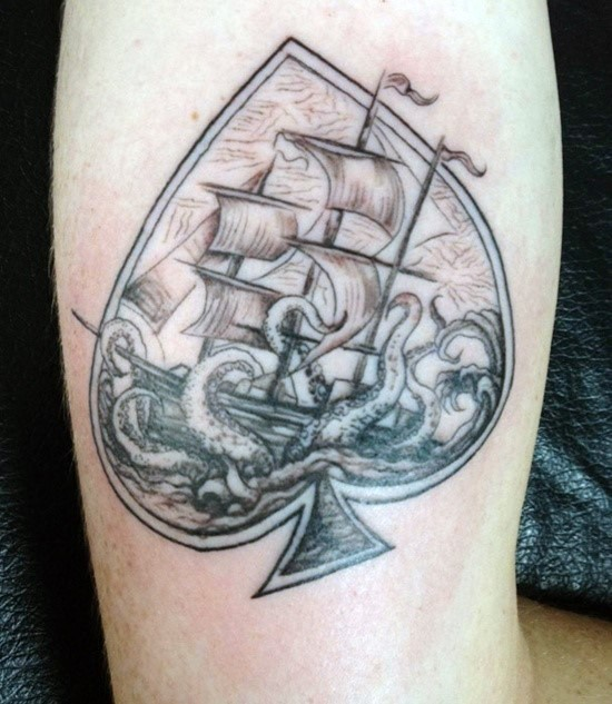 Nautical themed big spades symbol with octopus and ship tattoo on arm