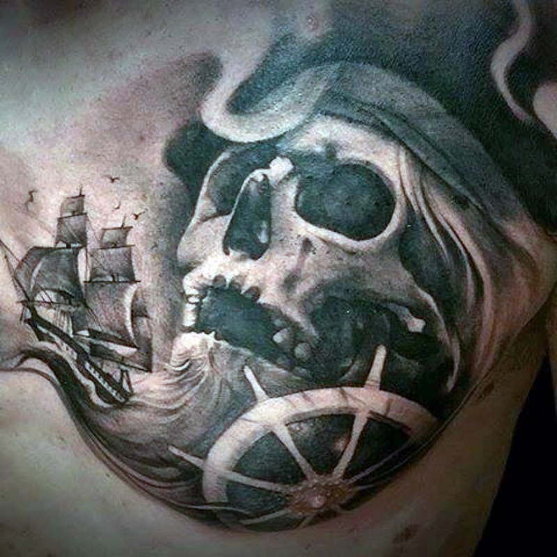 Nautical themed black and white pirate skull with ship tattoo on chest