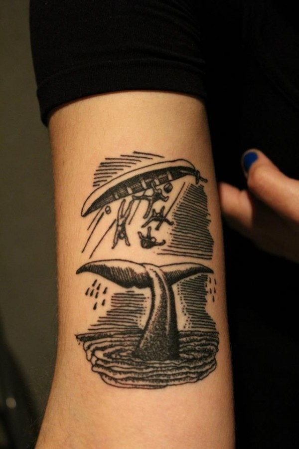 Nautical themed simple black ink wails tail with sailors tattoo on arm