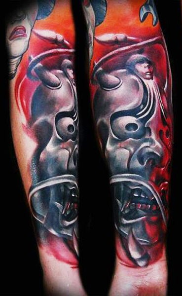 Neo japanese style colored arm tattoo of demonic mask