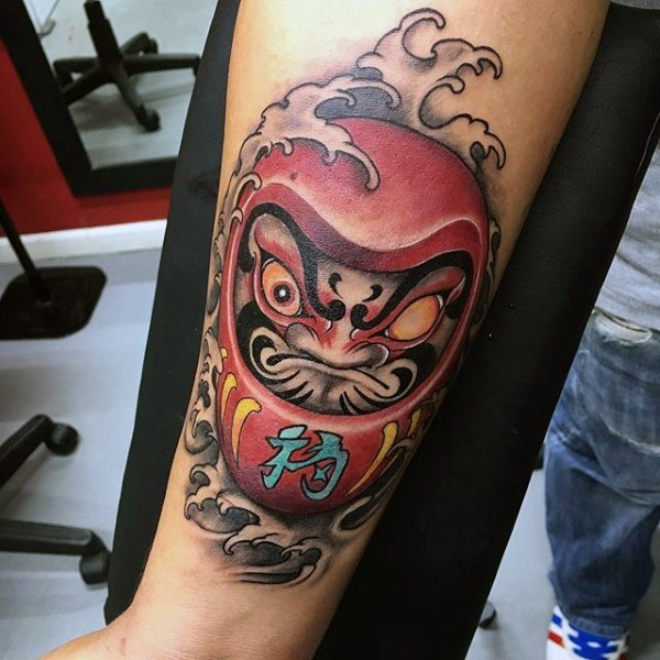 Neo japanese style colored arm tattoo of angry daruma doll