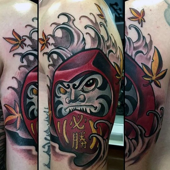 Neo japanese style colored shoulder tattoo of evil daruma doll with leaves