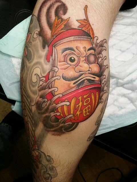 Neo japanese style colored tattoo of daruma doll with wave