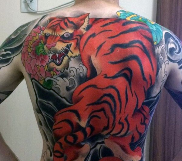 Neo japanese style colored whole back tattoo of big tiger and flower