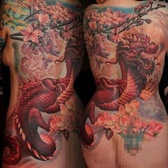 Neo japanese style colored whole back tattoo of big dragon with flowers and blooming tree