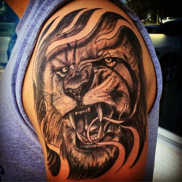 Neo Traditional Black And White Shoulder Tattoo Of Lion Head