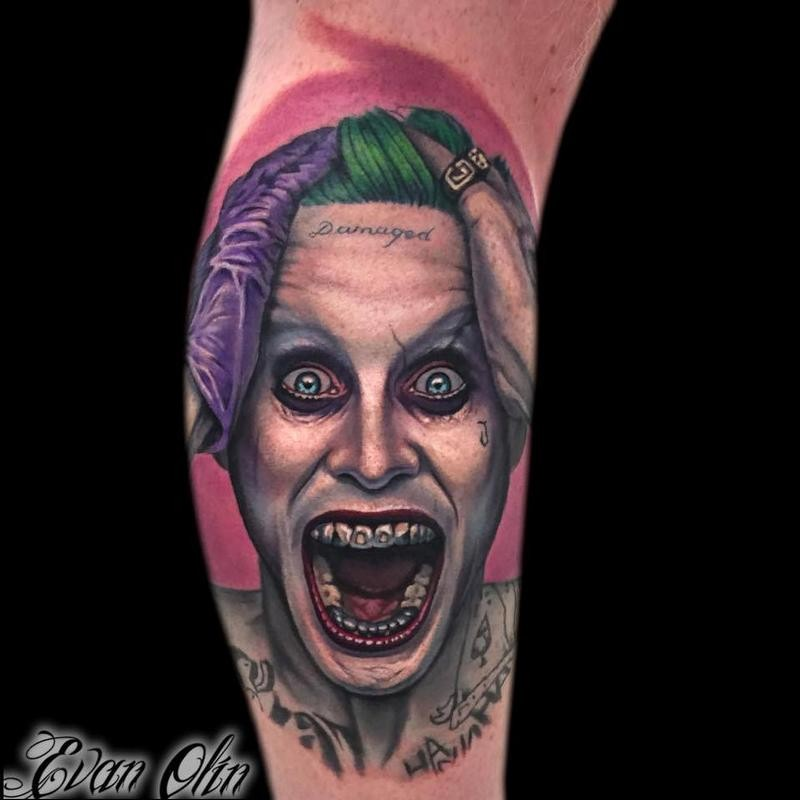 Neo traditional colored arm tattoo on creepy Joker face