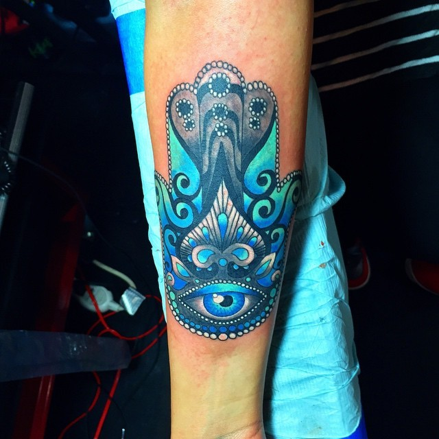 Neo traditional colored forearm tattoo of Hamsa symbol with eye and ornaments