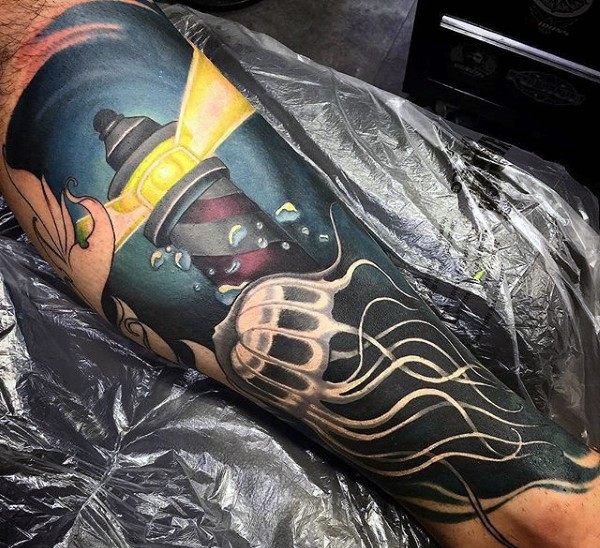 Neo traditional colored leg tattoo of underwater lighthouse and jellyfish