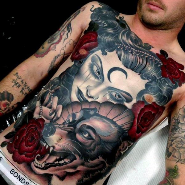 Neo traditional colored mystical woman with wolf tattoo on chest and belly combined with red roses