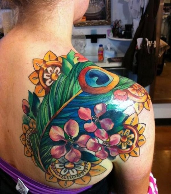 Neo traditional colored shoulder tattoo of peacock feather with flowers