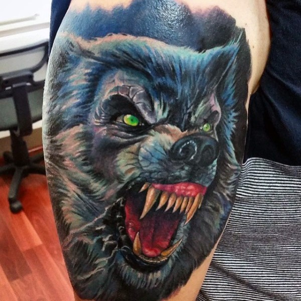 Neo traditional colored shoulder tattoo of very detailed werewolf face