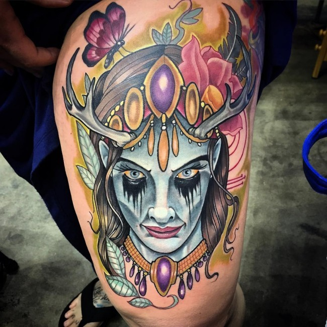 Neo Traditional Colored Thigh Tattoo Of Demon Face With Flowers And