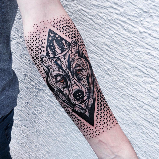 Neo traditional style colored arm tattoo of wolf head with ornaments