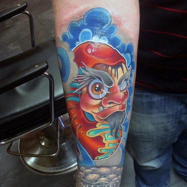 Neo traditional style colored arm tattoo of funny fantasy daruma doll