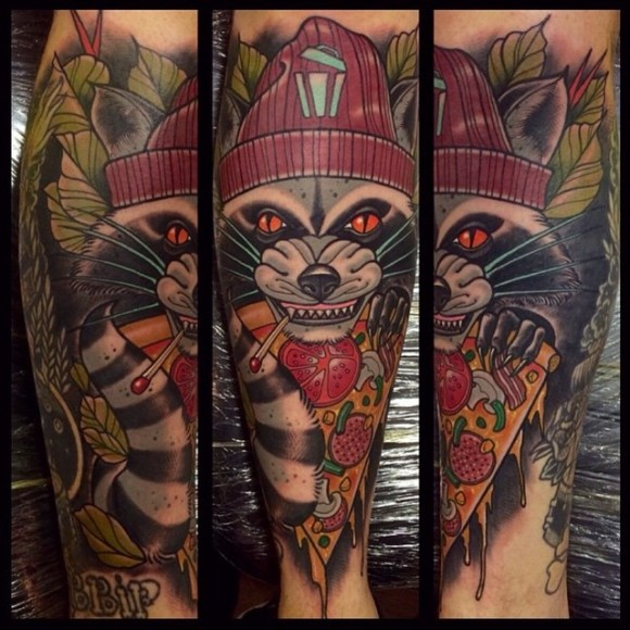 neo traditional style colored arm tattoo of evil raccoon