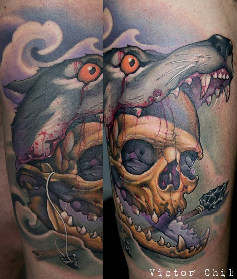 Neo traditional style colored arm tattoo of human skull in bloody wolf mouth