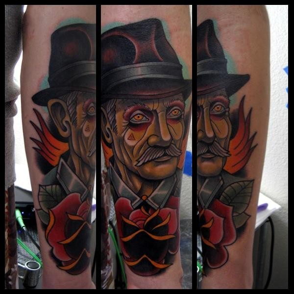 Neo traditional style colored forearm tattoo of old man with flowers