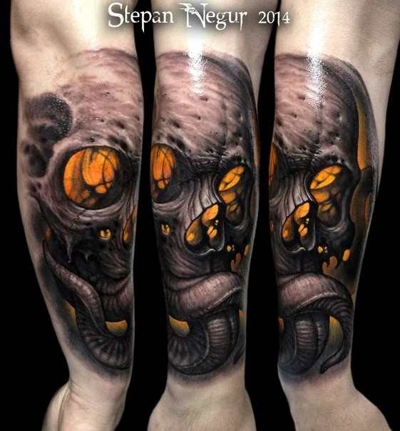 Neo traditional style colored forearm tattoo of creep demonic skull