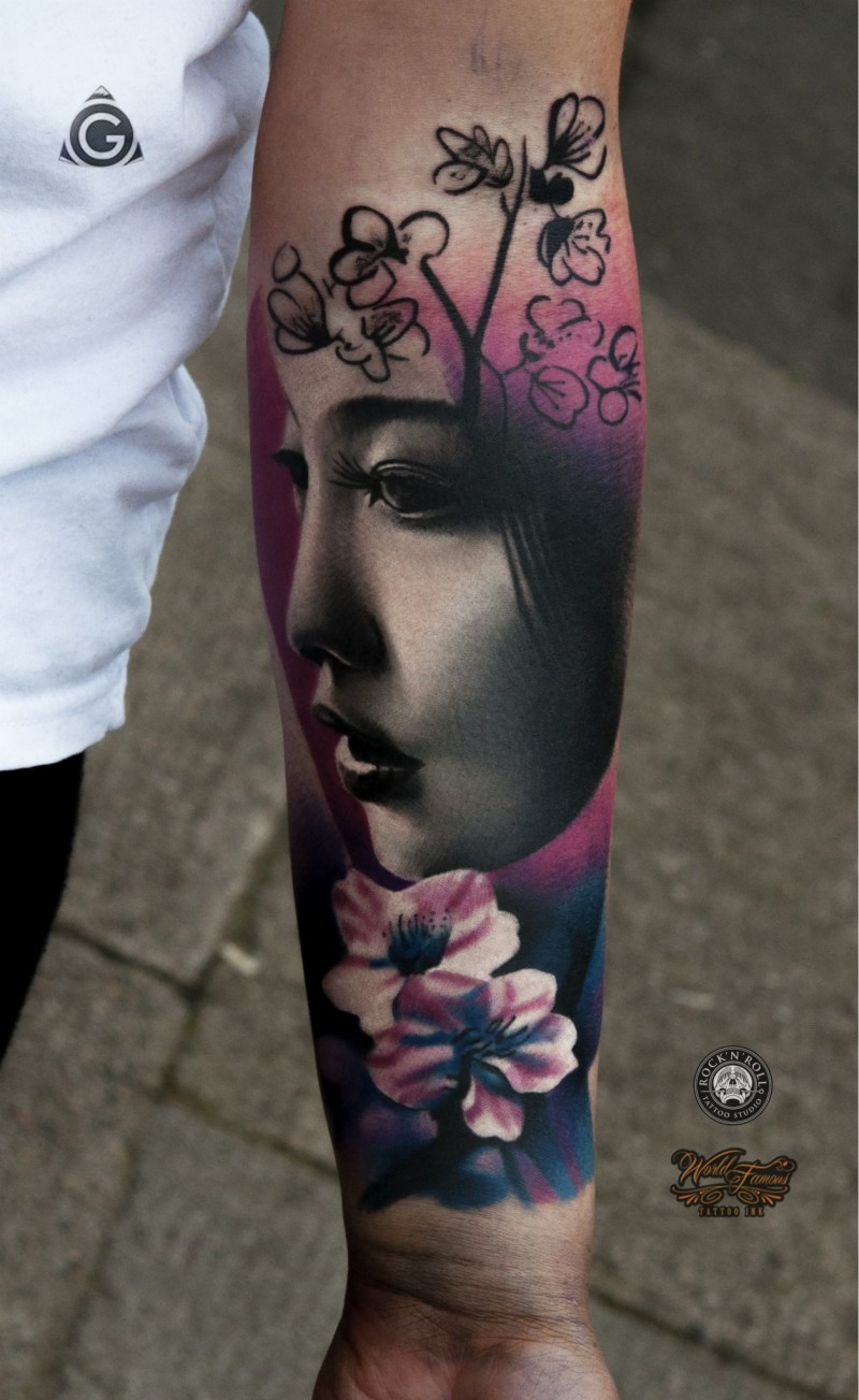 Neo traditional style colored forearm tattoo of Asian geisha with flowers