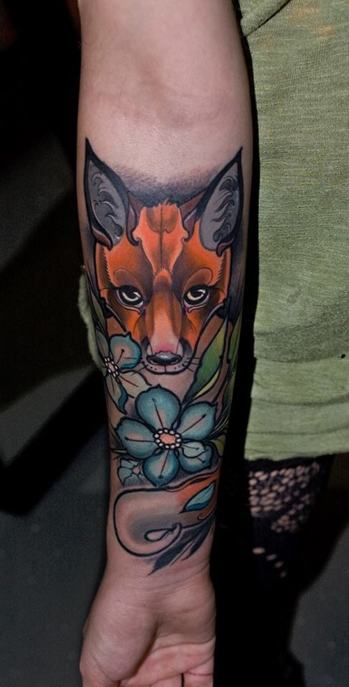 Neo traditional style colored fox tattoo on forearm with small flower