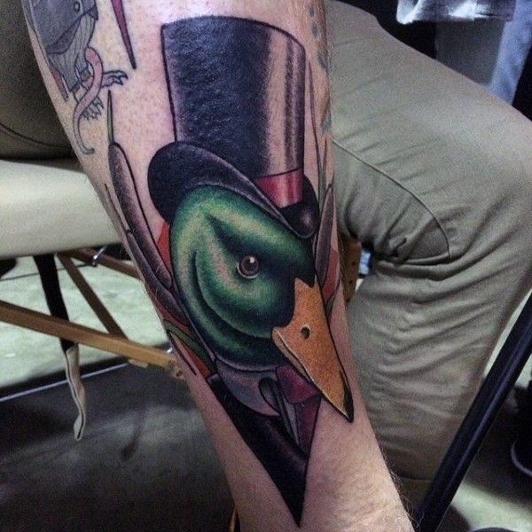 Neo traditional style colored gentleman like dick tattoo on leg